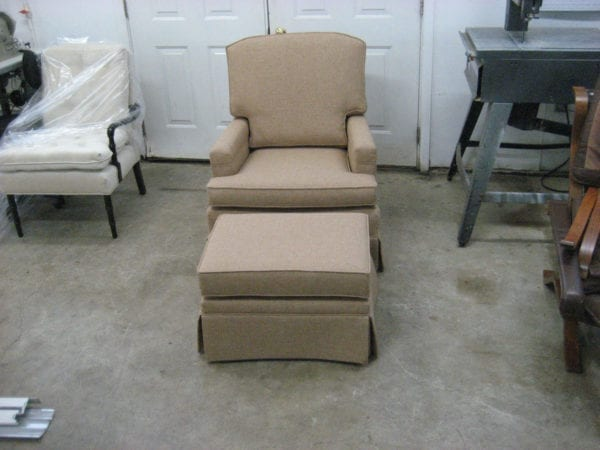 A Set With a Club Chair With an Ottoman Upholstery